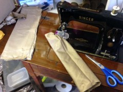 Strips of fbric being sewn into shape on an old Singer sewing machine