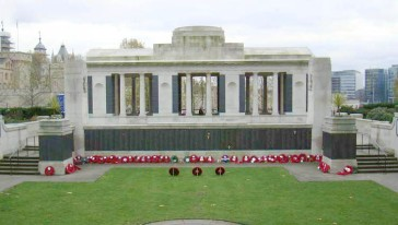 Photo of the memorial with poppy wreaths laid in front